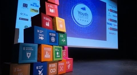 YouthSpeak Forum with the 17 Sustainable Development Goals as cubes on stage.